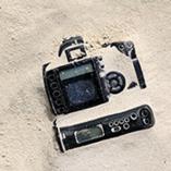 Appareil photo dans le sable